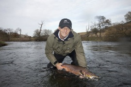 Sea Angler Magazines features editor Paul Fenech catching his first ever salmon a 9lb Dawyck fish. He is still smiling too