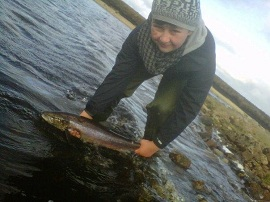 Ben Macaulay returning a 5lb hen fish to Loch an Ois during Saturday, October 6.