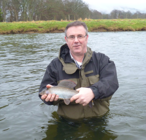 FishPal's CEO Mark Cockburn with a fine Tweed grayling