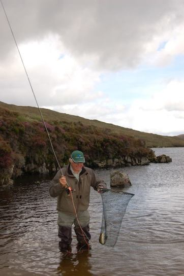 A member of the party with a trout